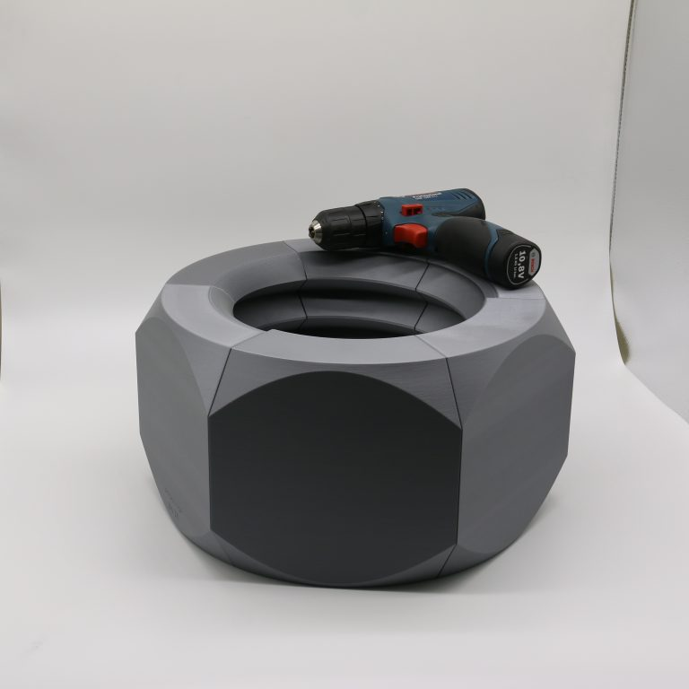 FDM 3D printed large scale model of nut is larger than a portable hand drill