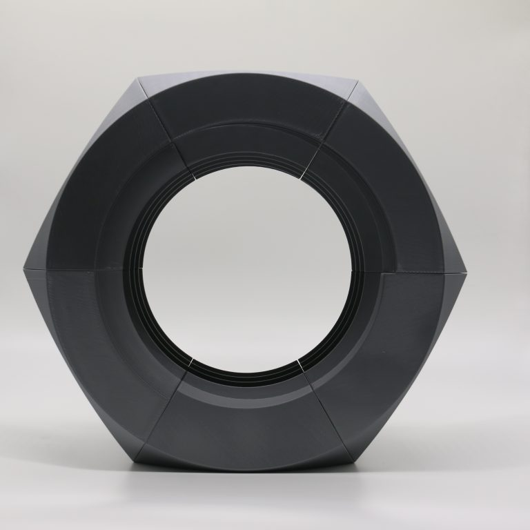 FDM 3D printed large scale model of nut in grey material - Front