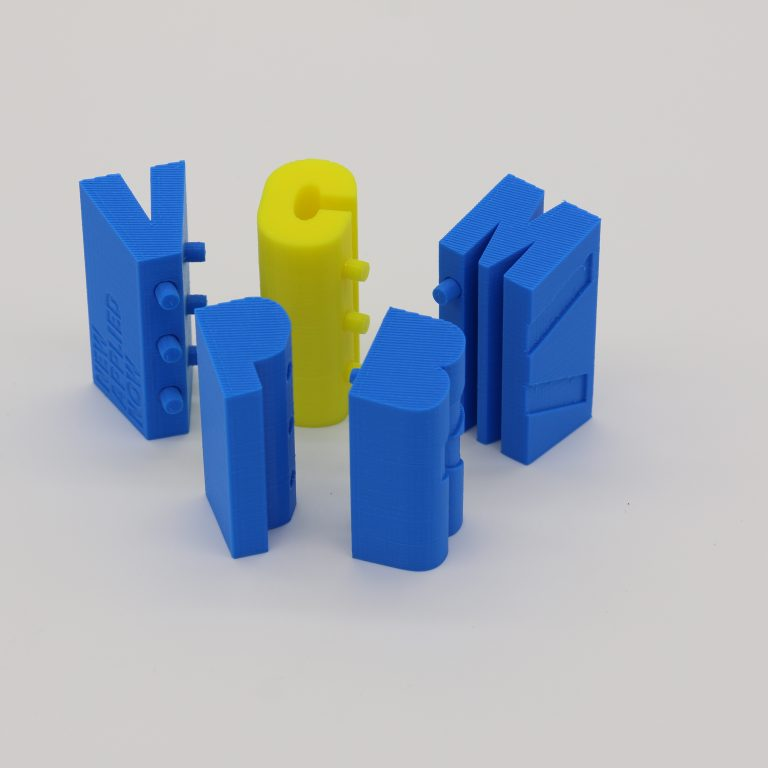 FDM 3D printed text blocks disassembled into individual characters - Top
