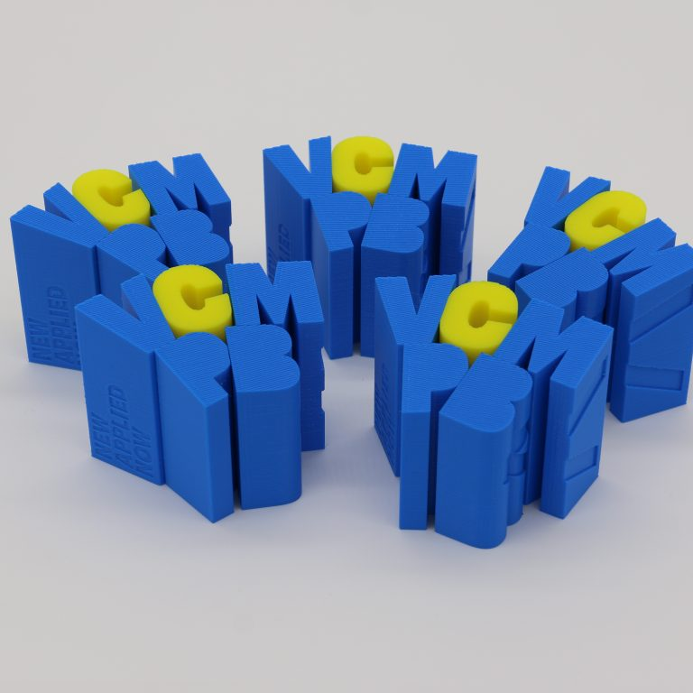 Multiple FDM 3D printed text blocks in blue and yellow materials