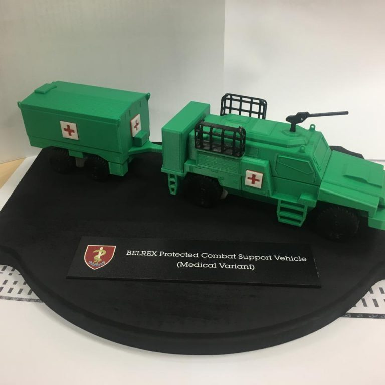 Multi-material FDM 3D printed scale model of BELREX Protected Combat Support Vehicle (Medical Variant) in green colour with black base plate